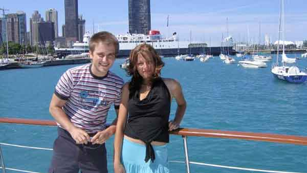 Two teenager posing for a photo on a charter yacht in Chicago IL, you can see Lake Michigan in the background