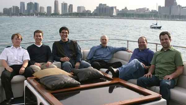 A group of men on a charter yacht in Chicago IL, you can see the city in the background