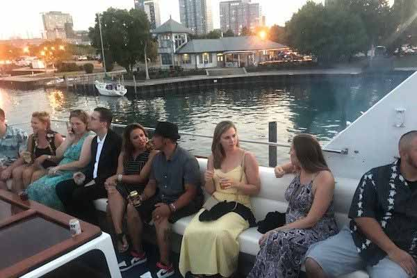 A group of people enjoying their Chicago boat rental