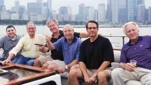 A group of six men on the top deck of a charter yacht in Chicago IL