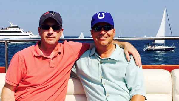 Two men wearing baseball caps on a charter yacht in Chicago IL