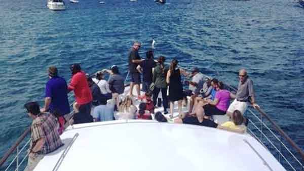 a party of guests taking a yacht tour of Chicago