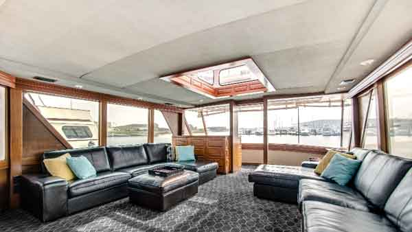 Lower deck of the Sophisticated Lady yacht has couches