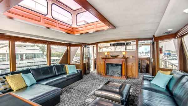 A yacht charter with a fire place the sophisticated lady